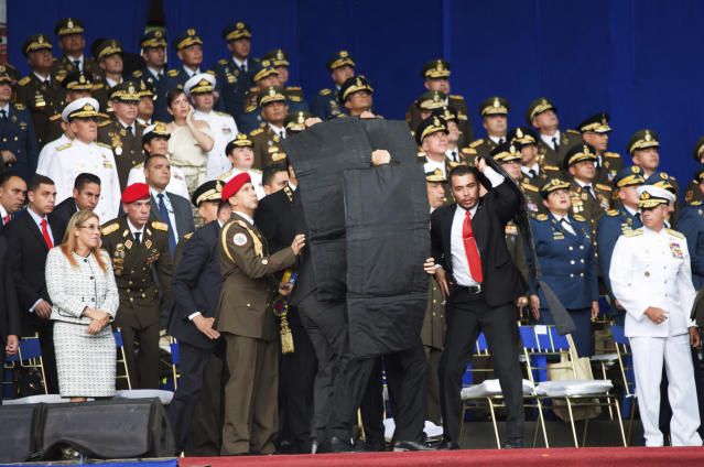 <p>Security personnel surround Venezuela's President Nicolas Maduro during an incident as he was giving a speech in Caracas, Venezuela, Saturday, Aug. 4, 2018. (Photo: Xinhua via AP) </p>