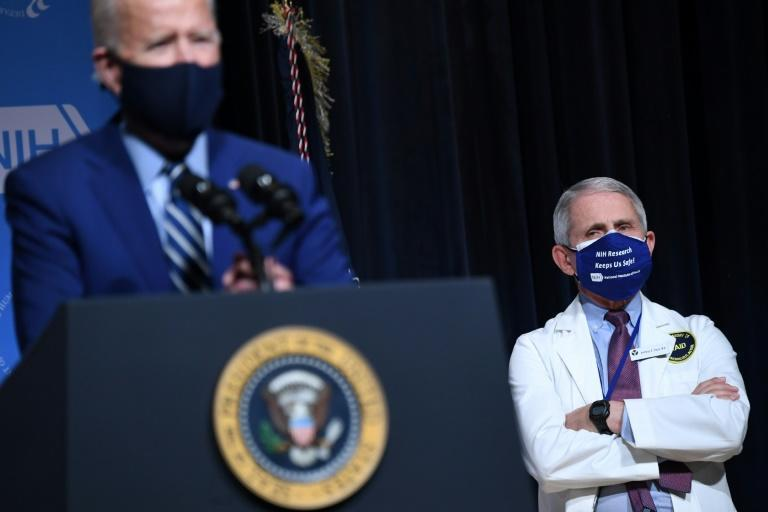 US President Joe Biden (L) appears alongside his top virus expert Anthony Fauci, who says a sense of normalcy may only return by the end of 2021