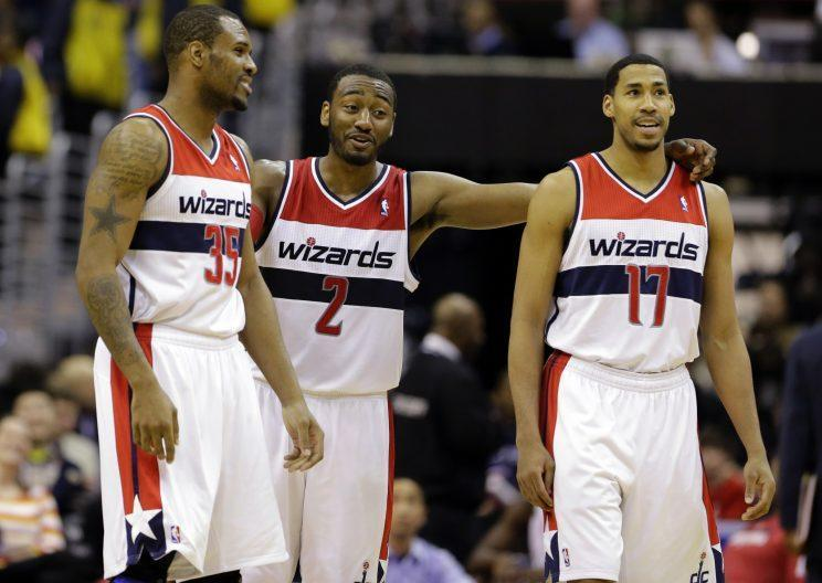 John Wall (2) may be regretting the day the Wizards parted ways with Trevor Booker (left) and Garrett Temple. (AP)