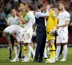 <p>England head coach Gareth Southgate embraces Jordan Pickford at the end of the match </p>