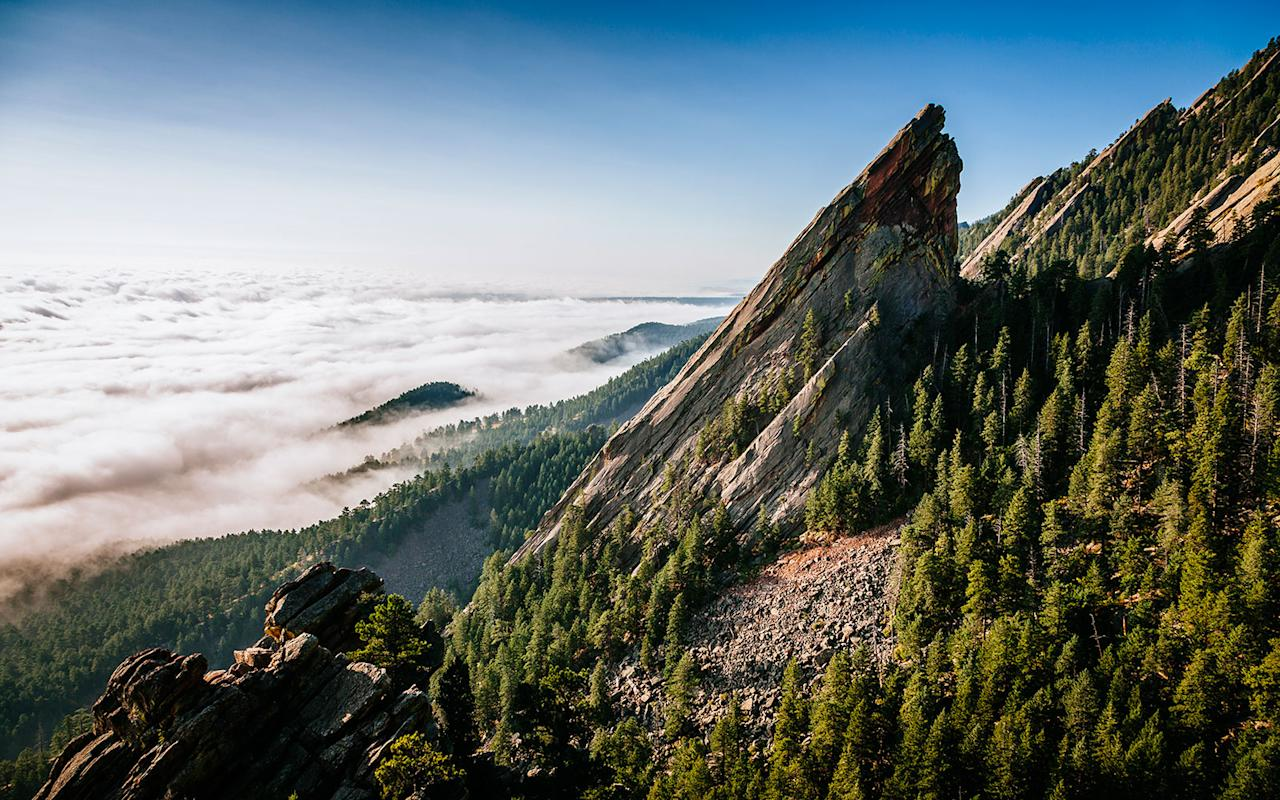 """<p>Not only is this <a rel=""""nofollow"""" href=""""http://www.travelandleisure.com/weekend-getaways/weekend-in-boulder-colorado"""">adventure-seekers' playground</a> super walkable, safe, and beautiful. it's also home to upscale hostels where all types of travelers converge around firepits and coffee bars to plan the following day's hike. (Tip: the new A-Lodge has a bed-and-ski deal for $99). You'll find free, pro-led biking and running groups all over town, but even those who are not athletically inclined can enjoy Boulder's charms. Head to the Rayback Collective food truck park to make friends and check out Fox Theater's live music schedule for a night on the town.</p>"""