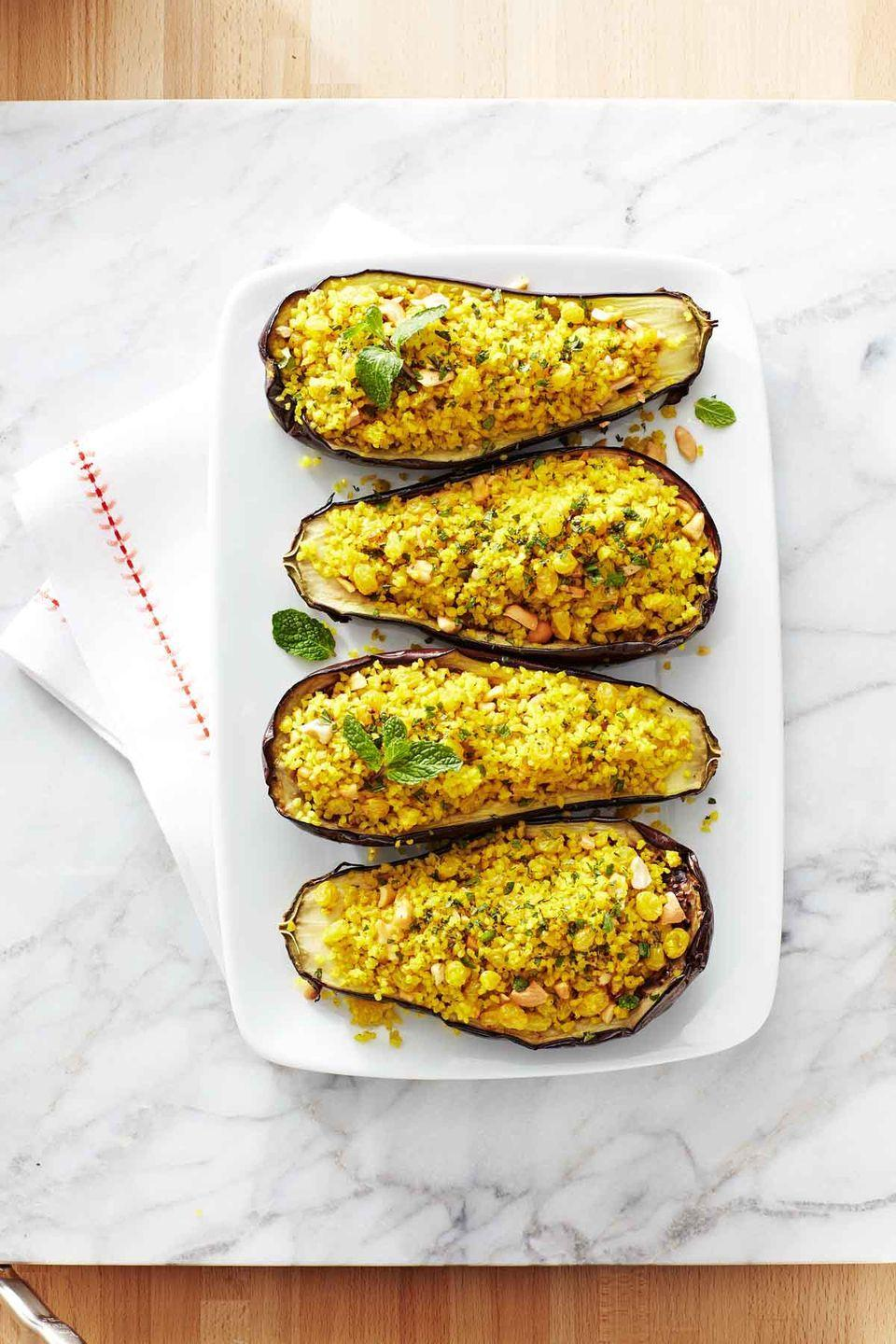 "<p>There are plenty of sweet and spicy flavors in these beautiful, presentation-worthy eggplant boats.</p><p><strong><a href=""https://www.countryliving.com/food-drinks/recipes/a34038/bulgur-cashew-stuffed-eggplant-recipe-ghk0215/"" rel=""nofollow noopener"" target=""_blank"" data-ylk=""slk:Get the recipe"" class=""link rapid-noclick-resp"">Get the recipe</a>.</strong></p><p><strong><a class=""link rapid-noclick-resp"" href=""https://www.amazon.com/Nordic-Ware-Natural-Aluminum-Commercial/dp/B0049C2S32/?tag=syn-yahoo-20&ascsubtag=%5Bartid%7C10050.g.34473510%5Bsrc%7Cyahoo-us"" rel=""nofollow noopener"" target=""_blank"" data-ylk=""slk:SHOP BAKING SHEETS"">SHOP BAKING SHEETS</a><br></strong></p>"