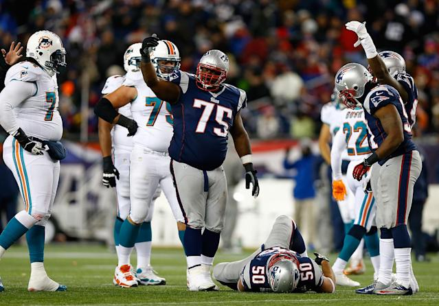 FOXBORO, MA - DECEMBER 30: Vince Wilfork #75 of the New England Patriots signals for medical attention for his teammate Rob Ninkovich #50 of the New England Patriots during the game against the Miami Dolphins at Gillette Stadium on December 30, 2012 in Foxboro, Massachusetts. (Photo by Jared Wickerham/Getty Images)