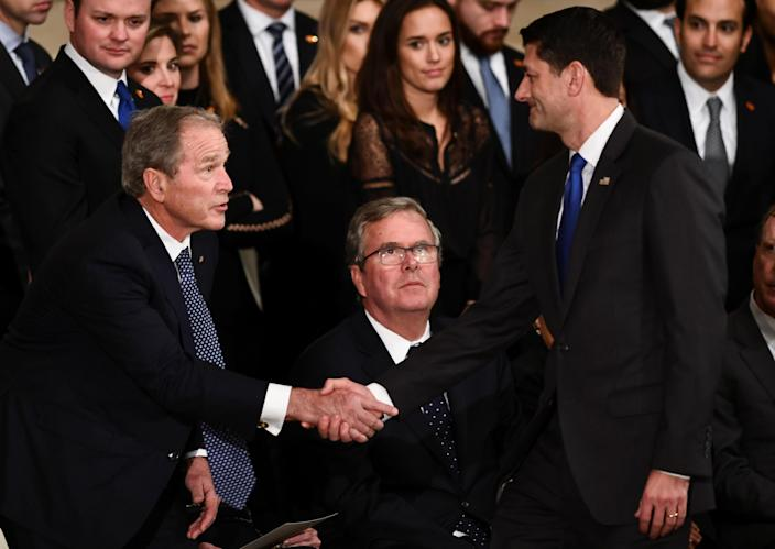 Speaker of the United States House of Representatives Paul Ryan (R-WI) (R) shakes hands with former US President George W. Bush as the late former President George H.W. Bush lies in state inside the Rotunda of the US Capitol, December 3, 2018 in Washington, DC. (Photo: Brendan Smialowski/Pool via Reuters)