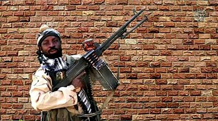 Boko Haram was dealt a devastating blow this year when its leader Abubakar Shekau, seen here in an image taken from a 2018 video, died during fighting with rival jihadists (AFP/Handout)