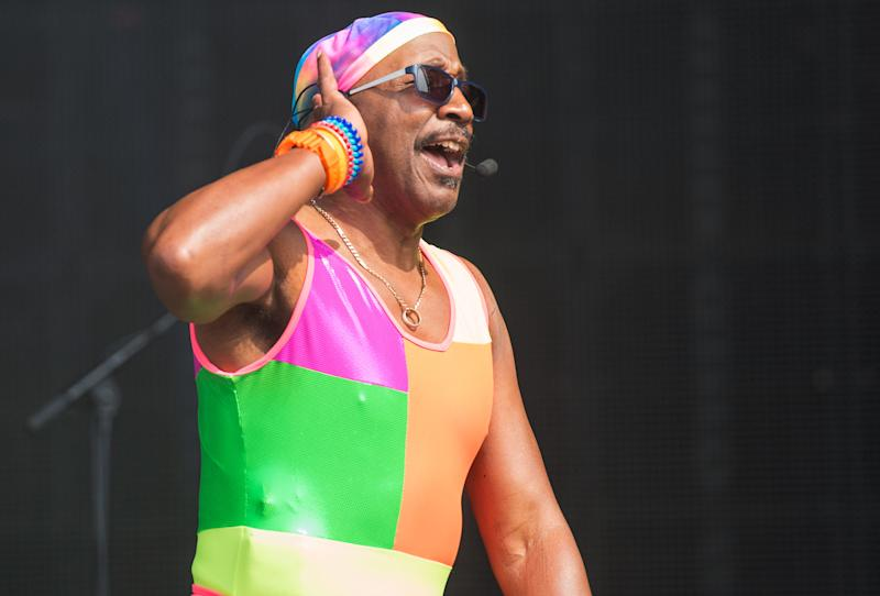NEWPORT, UNITED KINGDOM - SEPTEMBER 07: Derrick Evans, aka Mr Motivator, warms up the mainstage crowd on Day 4 of Bestival at Robin Hill Country Park on September 7, 2014 in Newport, Isle of Wight. (Photo by Ollie Millington/WireImage)