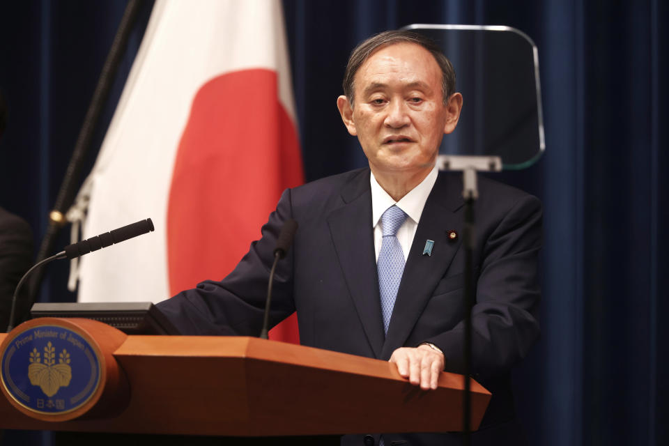 Japan's Prime Minister Yoshihide Suga speaks during a press conference at the prime minister's official residence Friday, May 28, 2021, in Tokyo. Japan extended a coronavirus state of emergency in Tokyo and other areas for 20 more days on Friday, with infections still not slowing as it prepares to host the Olympics in just over 50 days. (Behrouz Mehri/Pool Photo via AP)