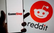 FILE PHOTO: GameStop logo is seen in front of displayed Reddit logo in this illustration
