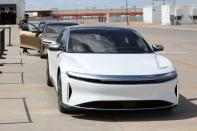 Workers assemble electric vehicles at the Lucid Motors plant in Casa Grande