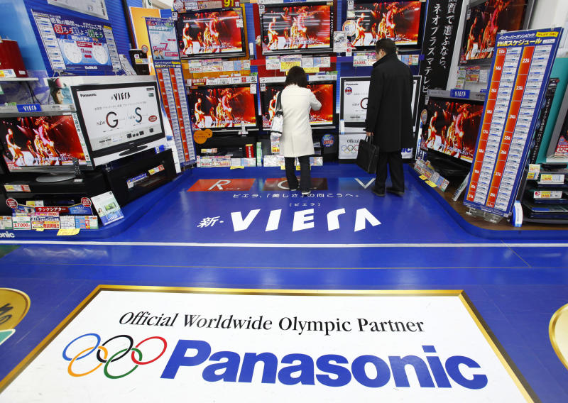 In this Jan. 28, 2010 file photo, shoppers look at Panasonic's flat-panel TVs at a discount store in Tokyo, Japan. Panasonic, Japan's biggest home appliance maker, said Friday, Oct. 29, 2010, its quarterly profit surged more than fivefold on strong consumer demand despite the strong yen and intensifying competition. (AP Photo/Shizuo Kambayashi, File)
