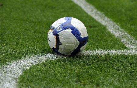 A football is rests on the pitch during the English Premier League soccer match between Burnley and Everton in Burnle