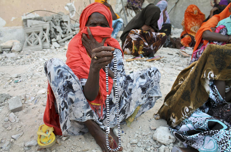 In this photo taken Friday, April 19, 2013, a Somali Sufi woman counts prayer beads during a ritual at the Sufi's main center in Mogadishu, Somalia. Sufism, a mystical branch of Islam, is having a comeback in Somalia since al-Shabab, an armed militant Islamic group, was pushed out of the capital in August 2011. (AP Photo/Farah Abdi Warsameh)