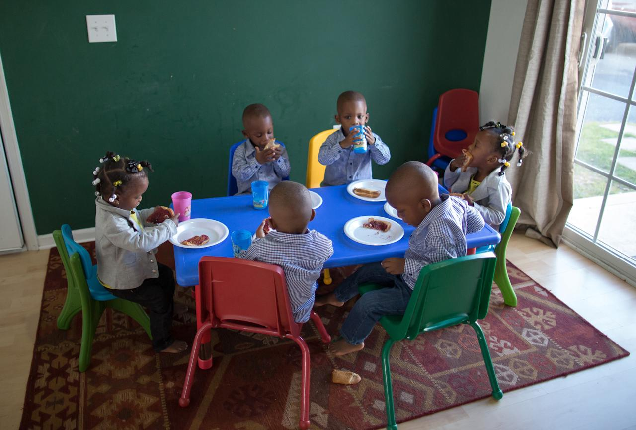 The McGhee sextuplets eat lunch at home in Columbus, Ohio.