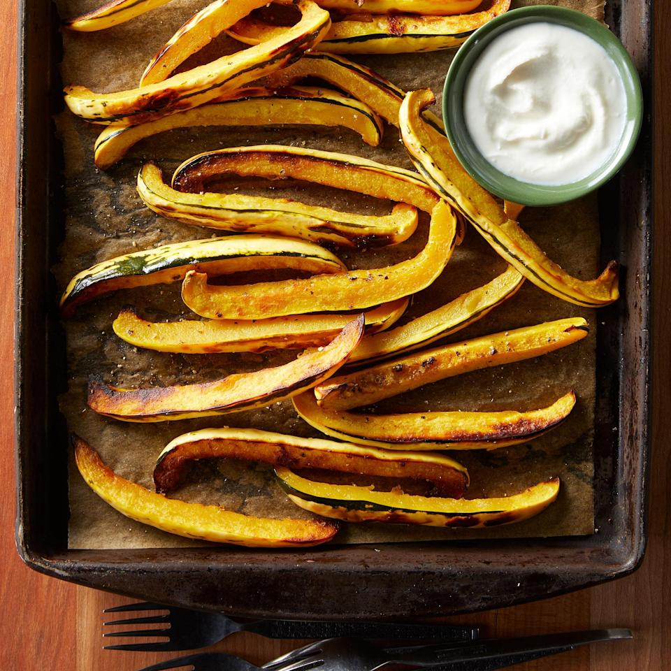 """<p>Sweet roasted delicata squash makes a great alternative to potato fries. The tender skin doesn't need to be peeled and the fries pair beautifully with a honey-sweetened goat cheese dipping sauce. <a href=""""https://www.eatingwell.com/recipe/7885417/delicata-squash-fries-with-whipped-honey-goat-cheese-dipping-sauce/"""" rel=""""nofollow noopener"""" target=""""_blank"""" data-ylk=""""slk:View recipe"""" class=""""link rapid-noclick-resp""""> View recipe </a></p>"""