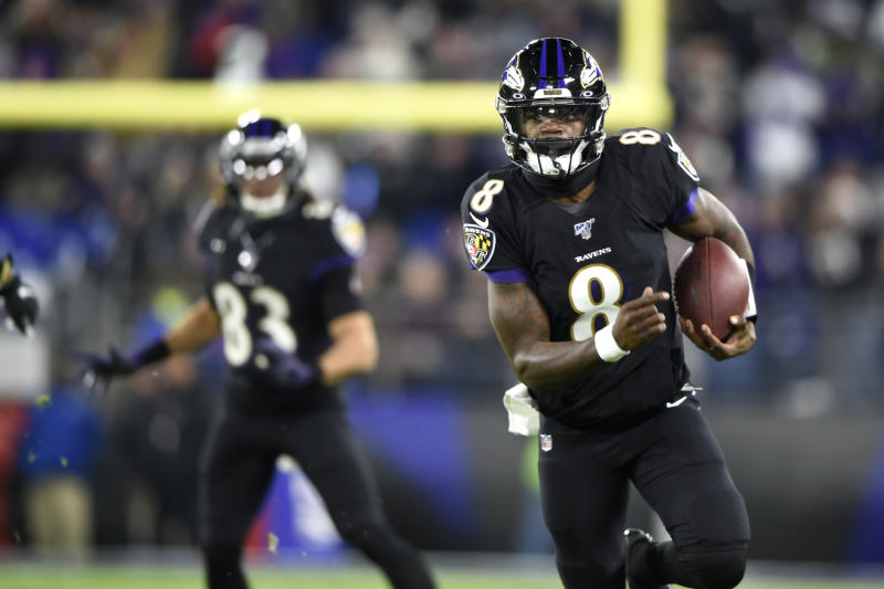 Baltimore Ravens quarterback Lamar Jackson (8) scrambles for yardage against the New York Jets during the first half of an NFL football game, Thursday, Dec. 12, 2019, in Baltimore. (AP Photo/Gail Burton)