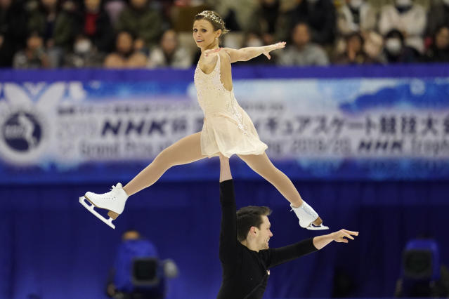 Kirsten Moore-Towers and Michael Marinaro of Canada perform in the pairs free skating program during the ISU Grand Prix of Figure Skating in Sapporo, northern Japan, Saturday, Nov. 23, 2019. (AP Photo/Toru Hanai)