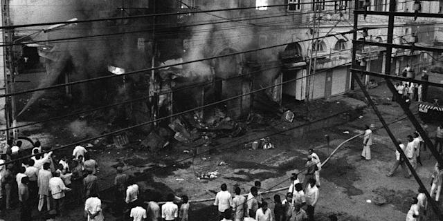 A building belonging to Sikhs burns in Daryaganj on November 2, 1984. Violence broke out in India in the wake of Prime Minister Indira Gandhi's assassination. Sikh alienation was deep and had dramatic consequences. On October 31, 1984, Indira Gandhi was assassinated by her two Sikh bodyguards, Beant Singh and Satwant Singh. The anger against Sikhs led to the terrible riots. (Photo: BEDI/AFP via Getty Images)