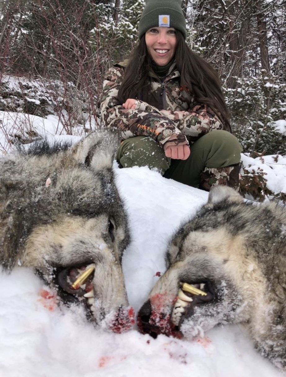 Kate Small, from Idaho in the US, is seen posing with two dead wolves.
