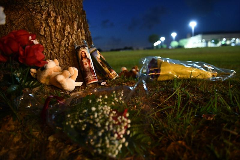 Residents bring memorial items to Santa Fe High School in Santa Fe Texas where a gunman identified as a 17-year-old student killed 10 people mostly students