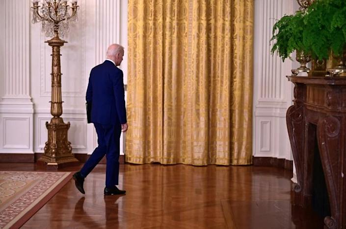 US President Joe Biden walks aways after delivering remarks on Russia at the White House