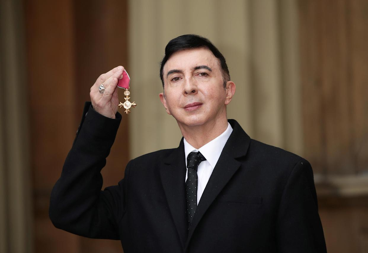 Marc Almond holds his OBE following a ceremony at Buckingham Palace in 2018. (Photo: Reuters/Yui Mok/Pool)