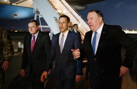 U.S. Secretary of State Mike Pompeo walks with Acting Assistant Secretary for Near Eastern Affairs at the State Department David Satterfield, and Charge D'affaires at the U.S. Embassy in Baghdad Joey Hood upon arrival in Baghdad, Iraq May 7, 2019. Mandel Ngan/Pool via REUTERS