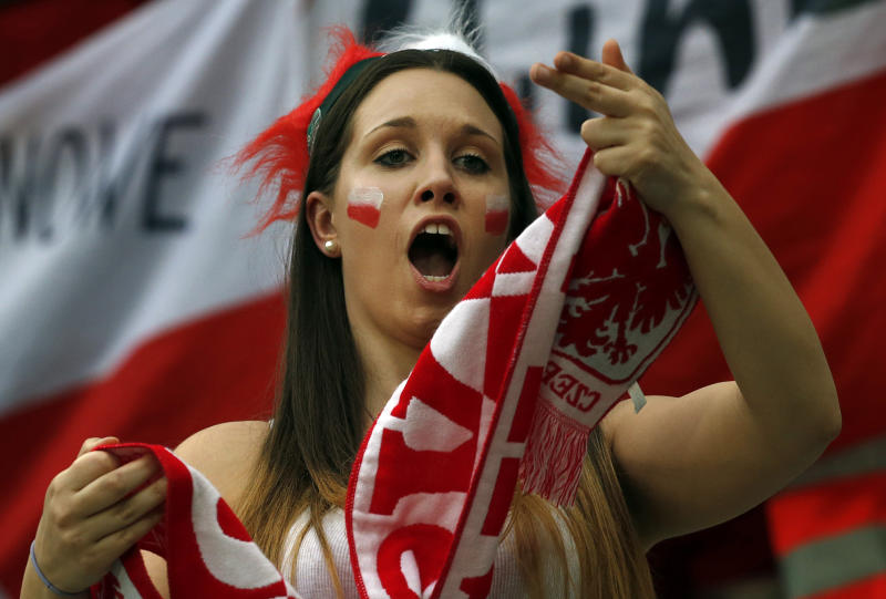 A Polish fan dances before the Euro 2012 soccer championship Group A match between Czech Republic and Poland in Wroclaw, Poland, Saturday, June 16, 2012. (AP Photo/Petr David Josek)