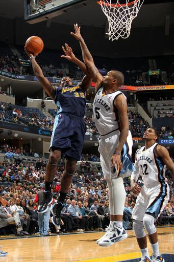 MEMPHIS, TN - FEBRUARY 17: Kenneth Faried #35 of the Denver Nuggets shoots over Marreese Speights #5 of the Memphis Grizzlies on February 17, 2012 at FedExForum in Memphis, Tennessee. (Photo by Joe Murphy/NBAE via Getty Images)
