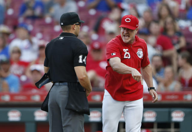 Cincinnati Reds manager David Bell (25) argues with home plate umpire Mark Wegner about whether Reds batter Jose Peraza was hit by a pitch during the ninth inning of a baseball game against the Chicago Cubs on Saturday, June 29, 2019, in Cincinnati. Bell was ejected. The Cubs won 6-0. (AP Photo/Gary Landers)