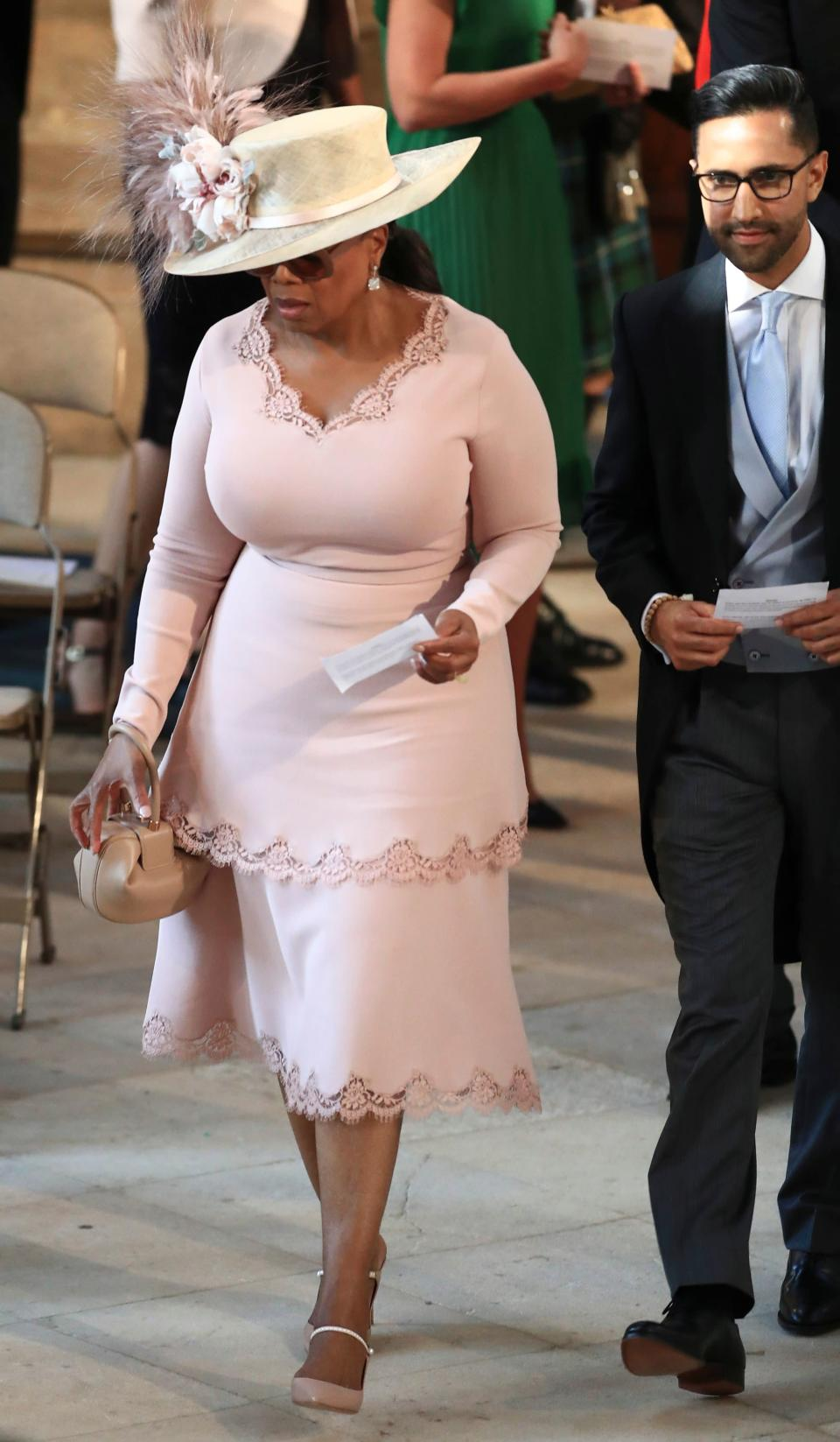 """Winfrey and her """"mystery man."""" Image via Getty Images."""