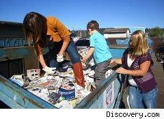 Family takes couponing to the extreme, searching in a dumpster for discarded coupons