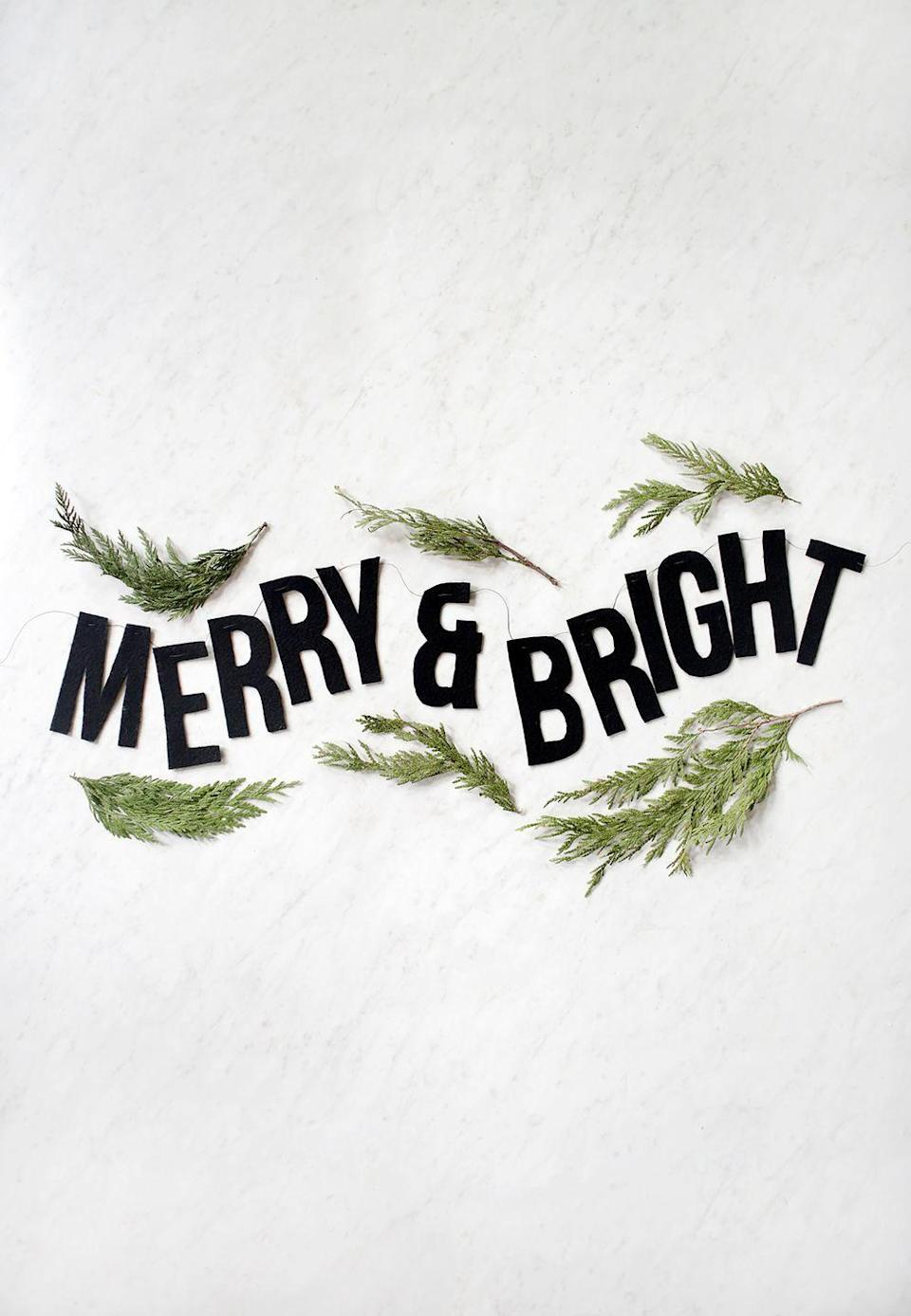 """<p>Black isn't typically the color of choice for the holidays, but this graphic felt garland makes the hue look surprisingly chic. </p><p><a href=""""https://themerrythought.com/diy/diy-felt-holiday-garland/"""" rel=""""nofollow noopener"""" target=""""_blank"""" data-ylk=""""slk:Get the tutorial."""" class=""""link rapid-noclick-resp"""">Get the tutorial.</a></p><p><a class=""""link rapid-noclick-resp"""" href=""""https://www.amazon.com/Mesheshe-Adhesive-Velvet-Flocking-Jewelry/dp/B07YWFSBRX?tag=syn-yahoo-20&ascsubtag=%5Bartid%7C10072.g.37499128%5Bsrc%7Cyahoo-us"""" rel=""""nofollow noopener"""" target=""""_blank"""" data-ylk=""""slk:SHOP FELT"""">SHOP FELT</a></p>"""