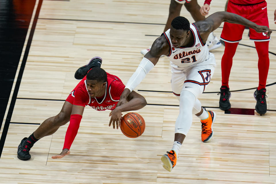 Ohio State forward E.J. Liddell (32) and Illinois center Kofi Cockburn (21) go for the ball during the second half of an NCAA college basketball championship game at the Big Ten Conference tournament, Sunday, March 14, 2021, in Indianapolis. (AP Photo/Michael Conroy)