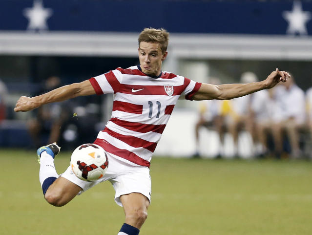 FILE - In this July 24, 2013, file photo, United States' Stuart Holden (11) attempts a shot on goal during a Gold Cup semifinal against Honduras in Arlington, Texas. Holden has undergone another operation to repair ligaments in his right knee and will be sidelined for six-to-nine months. Bolton, Holden's club in England's second-tier League Championship, made the announcement Tuesday, March 11, 2014, eight days after the 28-year-old lasted less than a half-hour with the Bolton under-21 team against Everton. (AP Photo/Brandon Wade, File)