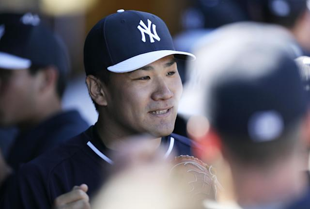 New York Yankees pitcher Masahiro Tanaka reacts with teammates after pitching the fifth inning in an exhibition baseball game against the Philadelphia Phillies Saturday, March 1, 2014, in Tampa, Fla. (AP Photo/Charlie Neibergall)