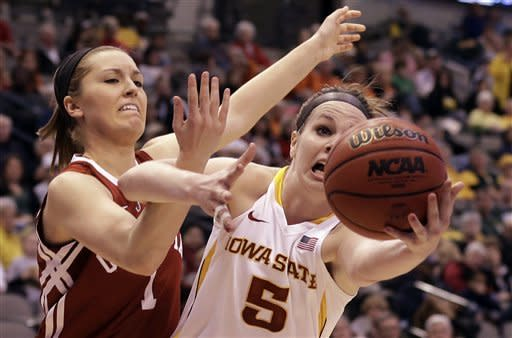 Iowa State's Hallie Christofferson (5) grabs a rebound away from Oklahoma's Nicole Kornet (1) in the first half of an NCAA college basketball game in the Big 12 Conference women's tournament Sunday, March 10, 2013, in Dallas. (AP Photo/Tony Gutierrez)