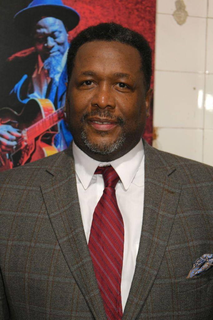 """<p>Wendell Pierce has kept himself busy with roles on <em>Numb3rs</em>, <em>Treme</em>, <em>The Michael J. Fox Show</em>, <em>Ray Donovan</em>, <em>Chicago P.D. </em>and <em>Tom Clancy's Jack Ryan</em>. He was also <a href=""""https://www.telegraph.co.uk/tv/2018/08/28/wendell-pierce-interview-told-meghan-markle-life-change/"""" rel=""""nofollow noopener"""" target=""""_blank"""" data-ylk=""""slk:the father of Meghan Markle's character"""" class=""""link rapid-noclick-resp"""">the father of Meghan Markle's character</a>, Rachel Zane, on <em>Suits. </em></p><p>He says he still watches <em>The Wire</em> from time to time, telling <a href=""""https://www.hbo.com/the-wire/interview-with-wendell-pierce"""" rel=""""nofollow noopener"""" target=""""_blank"""" data-ylk=""""slk:HBO"""" class=""""link rapid-noclick-resp"""">HBO</a>: """"I remember one time in particular—I was actually in Zimbabwe. I walked into my hotel room, turned on the television, and thought, 'Wait a minute, that sounds like me.'""""</p>"""