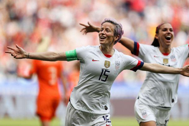 PHOTO:Megan Rapinoe of the USA celebrates scoring the first goal from the penalty spot with Alex Morgan during the 2019 FIFA Women's World Cup France Final match between The United State of America and The Netherlands at Stade de Lyon on July 07, 2019. (Richard Heathcote/Getty Images)