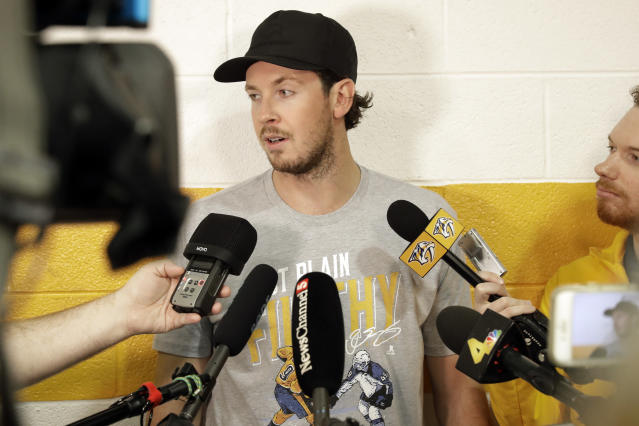 Nashville Predators center Ryan Johansen answers questions as players report to NHL hockey training camp Thursday, Sept. 12, 2019, in Nashville, Tenn. (AP Photo/Mark Humphrey)