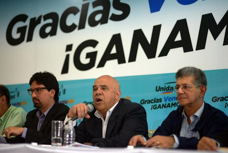 "Jesus ""Chuo"" Torrealba (C) gives a speech next to Venezuelan deputy for the Accion Democratica party Henry Ramos Allup (R) and Deputy elect for the National Assembly Fredy Guevara (L) during a press conference in Caracas on December 11, 2015"