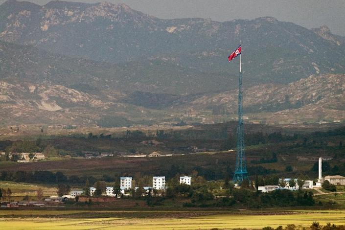 A North Korean flag flutters over Gijungdong village as seen from an observatory point in Paju -- near the Demilitarized Zone (DMZ) that divides the Korean peninsula (AFP Photo/Kim Doo-Ho)