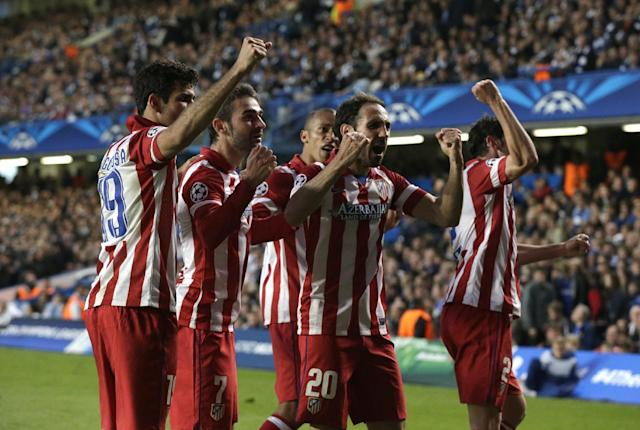 Atletico's Adrian Lopez, second left, celebrates with teammates after scoring his sides first goal during the Champions League semifinal second leg soccer match between Chelsea and Atletico Madrid at Stamford Bridge stadium in London, Wednesday, April 30, 2014. (AP Photo/Matt Dunham)