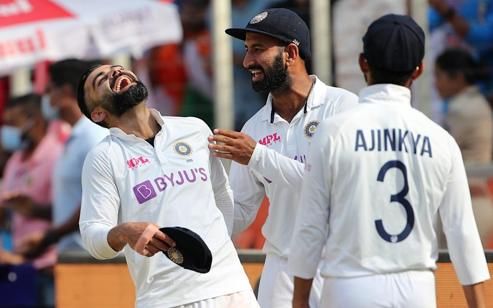 India celebrate after thrashing England - GETTY IMAGES