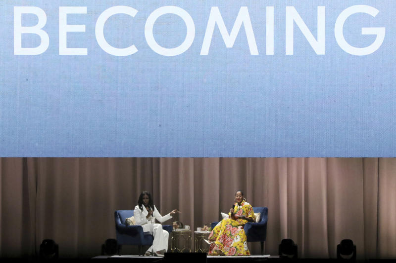 """Former first lady Michelle Obama, left, and Tracee Ellis Ross speak at the """"Becoming: An Intimate Conversation with Michelle Obama"""" event at the Forum on Thursday, Nov. 15, 2018, in Inglewood, Calif. (Photo by Willy Sanjuan/Invision/AP)"""