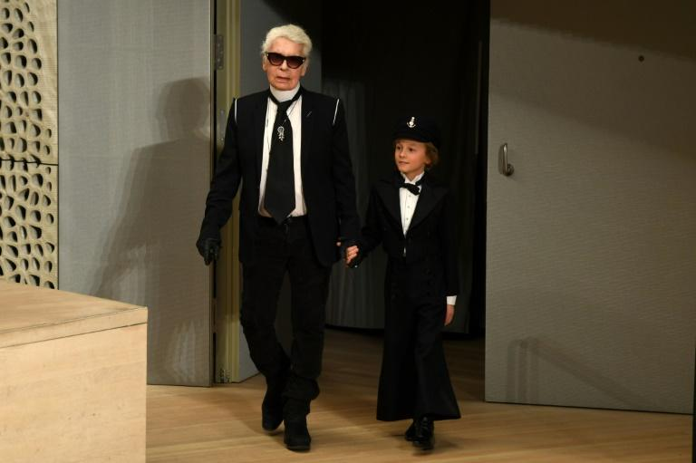 German fashion designer Karl Lagerfeld with his  godson Hudson Kroenig on  stage