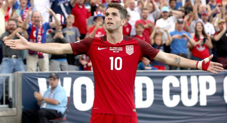 Christian Pulisic celebrates scoring a goal against Trinidad & Tabago during the FIFA 2018 World Cup Qualifier on Thursday in Commerce City, Colorado. (Matthew Stockman/Getty Images)