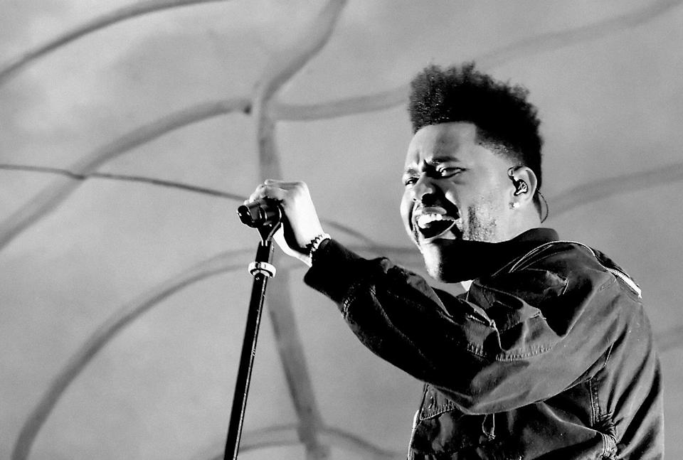 <p>Performing on stage at Coachella in 2018, The Weeknd appeared to have a trimmed his hairline significantly. </p>