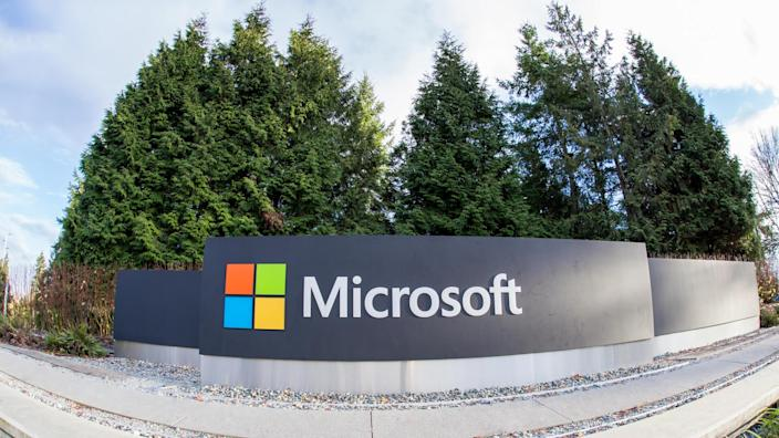 Redmond, WA, USA - January 30, 2018: One of the biggest Microsoft signs is placed next to green trees at a public intersection near Microsoft's Redmond campus.
