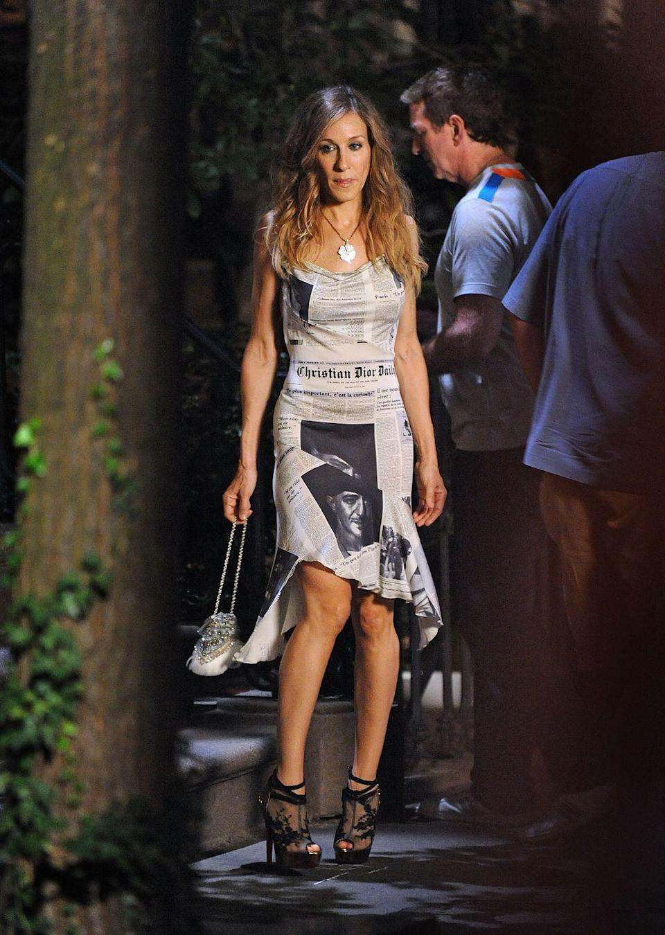<p>Similar to an outfit we saw in the <em>Sex and the City</em> series, Sarah Jessica Parker's newspaper-print dress (made by John Galliano) became a point of interest when she re-wore the piece for <em>Sex and the City 2. </em></p>