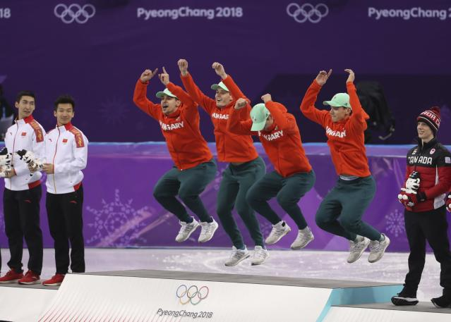 Short Track Speed Skating Events - Pyeongchang 2018 Winter Olympics - Men's 5000m Relay Final - Gangneung Ice Arena - Gangneung, South Korea - February 22, 2018 - Gold medallists Viktor Knoch, Csaba Burjan, Liu Shaoang and Sandor Liu Shaolin of Hungary jump in celebration on the podium. REUTERS/Lucy Nicholson